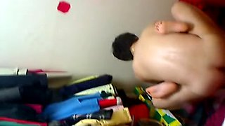 Voyeur video of a young Asian couple fucking in their room