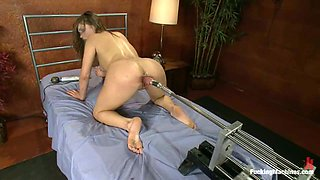 Ashlynn Leigh moans loudly while being fucked by a fucking machine