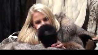 Hot blonde in fur teasing hj with a dildo 2