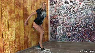 Lewd clothed hooker gets messy in the glory hole room