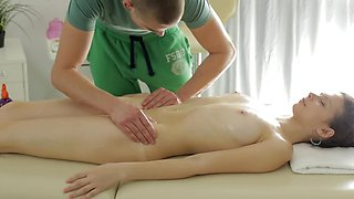 Hot oral sex action on the massage table with lovely brunette girl
