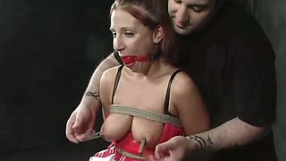 Red haired babe Rebecca with juicy boobies is punished