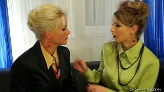 Voracious business ladies plays with vibrators on big leather couch