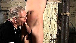 Stripped gay hunk enjoys sadomasochism