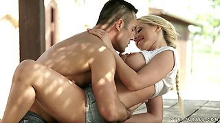 Blonde on a picnic table making love to her man