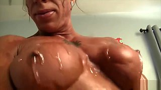 Oiled Muscular SLUT Fingering her BIG CLIT and DILDOING