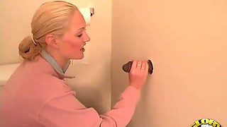 Mesmerizing blonde and her amazing time with the black gloryhole cock